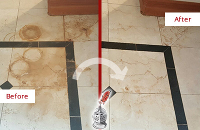 Before and After Picture of a Neptune Hard Surface Restoration Service on a Marble Floor to Eliminate Rust Stains